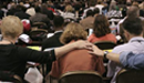 General Conference delegates pray over their decision making.