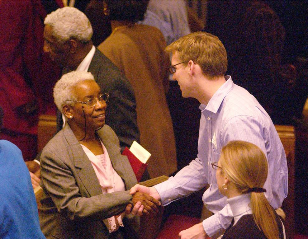 Parishioners of predominantly white Foundry United Methodist Church and predominantly black Asbury United Methodist Church in Washington greet each other during a 'service of confession and repentance.' A UMNS photo © Jay Mallin.