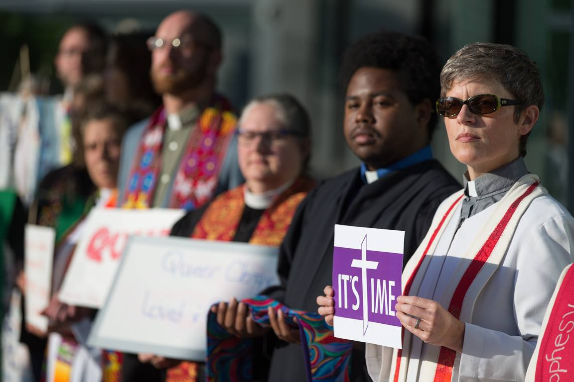 Protestors in support of LGBTQ clergy line the entryway to the 2016 United Methodist General Conference May 18 in Portland, Ore. Many wore or carried  clergy stoles of defrocked clergy.