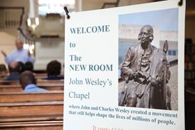 The sign at the entrance of the New Room, celebrates the ministry of John and Charles Wesley yesterday and today. Photo by Kathleen Barry, United Methodist Communications.