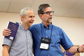 The Rev. Steve Manskar (r) leads Wesley Pilgrimage in England, which includes teaching from experts like the Rev. Phil Meadows. Photo by Kathleen Barry, United Methodist Communications.
