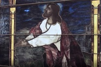 A genuine Tiffany glass window depicts Jesus in the Garden. The panel is on display in the lobby of the General Commission on Archives and History in Madison, New Jersey.