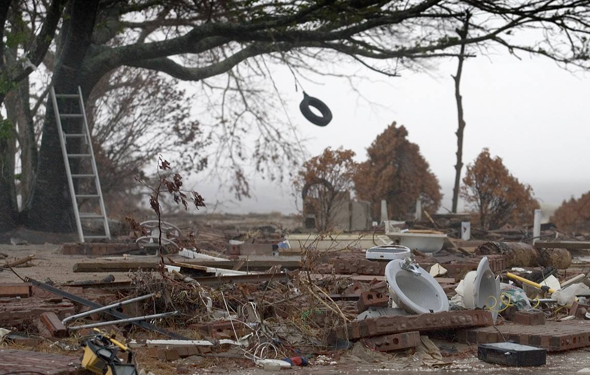 A tire swing sways in the wind from Hurricane Rita over the remains of a beachfront home destroyed by Hurricane Katrina in Ocean Springs, Miss. Rita made landfall in East Texas Sept. 24, 2005, nearly four weeks after Katrina hit Louisiana and Mississippi. Photo by Mike DuBose, UMNS.