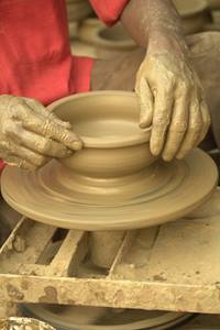 A potter's wheel illustrates how God continues to mold us.