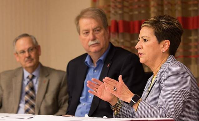 Bishop Cynthia F. Harvey (right) answers questions during a press conference about the United Methodist Church's Way Forward plan to address how the denomination ministers with LGBTQ individuals. She is flanked by Bishops Bruce R. Ough (left) and Kenneth H. Carter. Photo by Mike DuBose, UMNS.