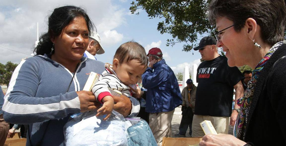 United Methodist bishops help families during an immersion experience at the U.S./Mexico border in May, 2013. File photo by Kathleen Barry, UMNS.