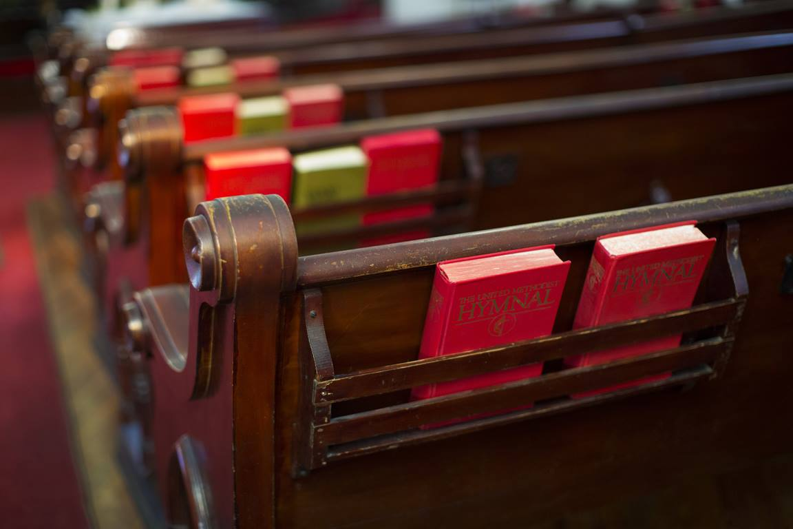 Pews and hymnals photographed inside Monroe Street United Methodist Church in historic Germantown, Nashville, Tenn. Photo by Kathleen Barry, United Methodist Communications