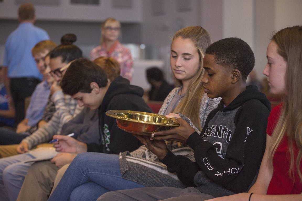 Young adults pass the collection plate during the contemporary worship at McKendree United Methodist Church in Lawrenceville, Ga. Photo by Kathleen Barry, UM News.