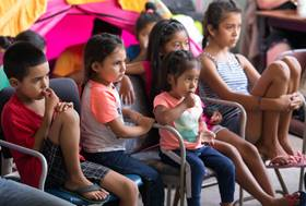 Children watch cartoons on television at the Movimiento Juventud 2000 shelter in Tijuana's Zona Norte neighborhood. Photo by Mike DuBose, UMNS.