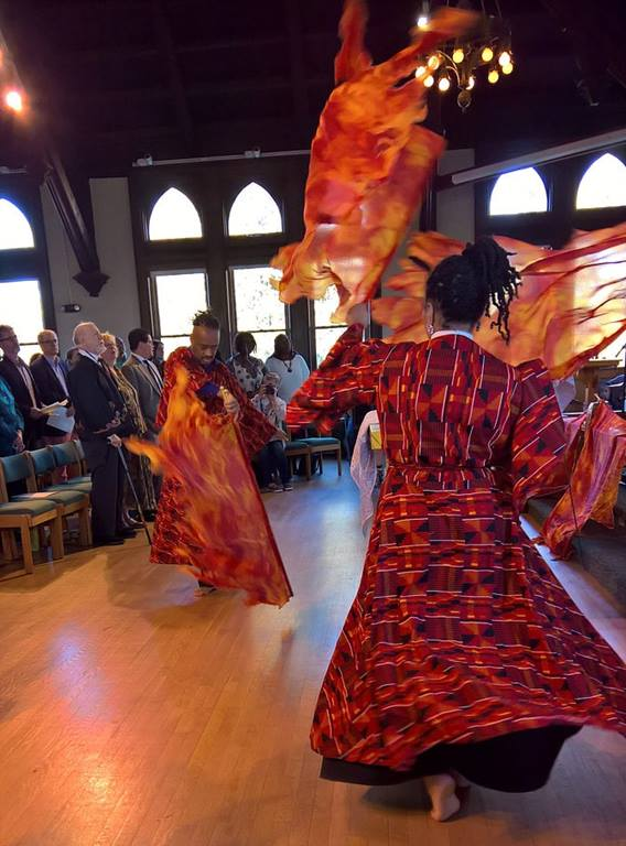 Liturgical dancers use flame-shaped banners. Courtesy photo from the Rev. Todd Pick's website, www.wordmadeimage.com.