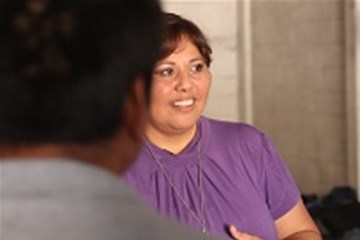 Maritza Velazquez-Cota offers food and comfort to families in an immigration shelter at the U.S.-Mexico Border.