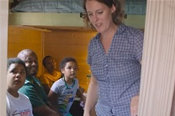 Rev. Rebecca Rutter gives a tour of the 98 sq ft tiny house she built. Video image by United Methodist Communications.