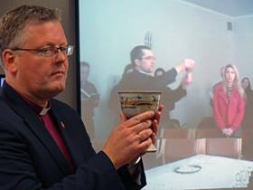 Bishop Christian Alsted of Northern Central Europe celebrated communion with a congregation in Huntsville, Alabama, as the Rev. Remigijus Matulaitis celebrated with a congregation in Lithuania as part of the In Mission Together Lithuania 50/50 Partnership Summit in June 2015. Each congregation was able to see the other over the internet. Photo courtesy of the Rev. Patrick Friday, In Mission Together.