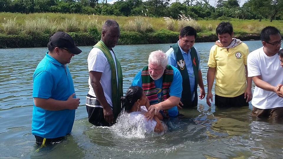 The Rev. Joey Galinato of Good Samaritan United Methodist Church, the Rev. Michael McQueen of St. James United Methodist Church and the Rev. Ronny Branen of Prospect United Methodist Church, all from the North Georgia Conference, join in baptizing 47 people in a river in Angat, Philippines. Photo by the Rev. Joey Galinato