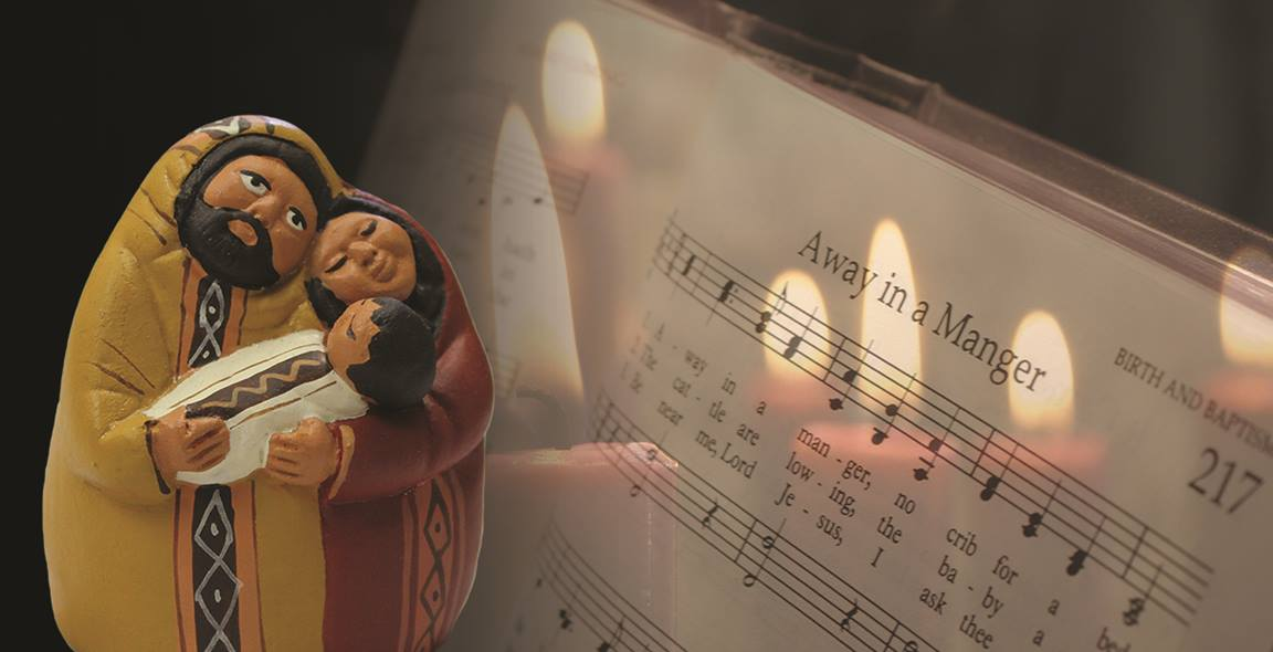 """Nativity set and sheet music for """"Away in a Manger"""" are part of a photo illustration by Kathryn Price, United Methodist Communications."""