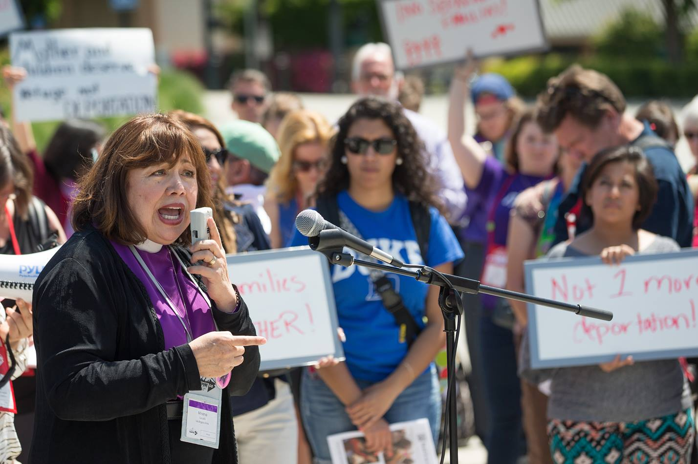 Bishop Minerva Carcaño addresses a rally of Methodists in support of immigration reform rally at the Convention Center Plaza outside the 2016 United Methodist General Conference in Portland, Ore.