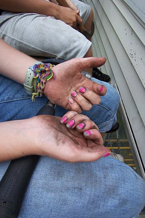 A young ladies displays her pink fingernails and dirty hands during a SOWER Work Mission project. Photo courtesy of the Rev. Dawn Livingston.