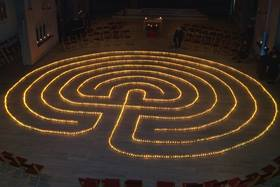 A lit prayer labyrinth.