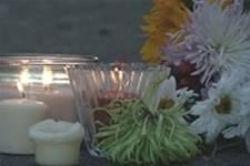A street memorial remembers crime victims. Chaplain Bruce Cook runs a support group for families who have lost loved ones to violent crimes.