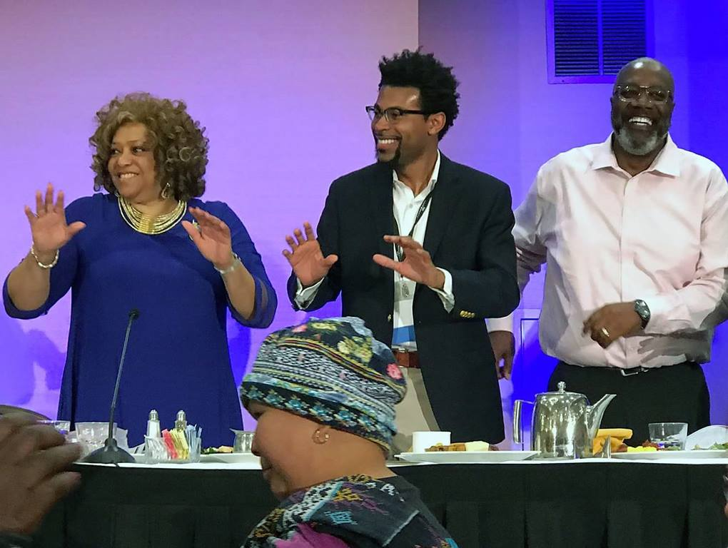 Deborah Dangerfield, president of the Black Methodists for Church Renewal (left), the Rev. Theon Johnson, associate pastor of Glide United Methodist Church (center), and the Rev. Anthony Jenkins, Western Jurisdiction BMCR chair, dance during the closing Gospel brunch at the BMCR 51st general meeting, March 17 in Sacramento, California. Photo by Mai Yang.