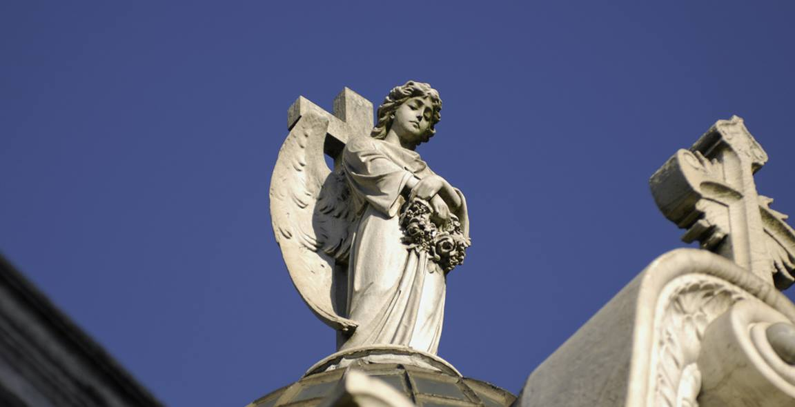 An angel in the Recoleta Cemetery (Spanish, Cementerio de la Recoleta) located in Buenos Aires, Argentina. The cemetery is located at the church of Our Lady of Pilar (Nuestra Señora del Pilar Basilica) which was built in 1732. Photo by Godot13, courtesy Wikimedia Commons.