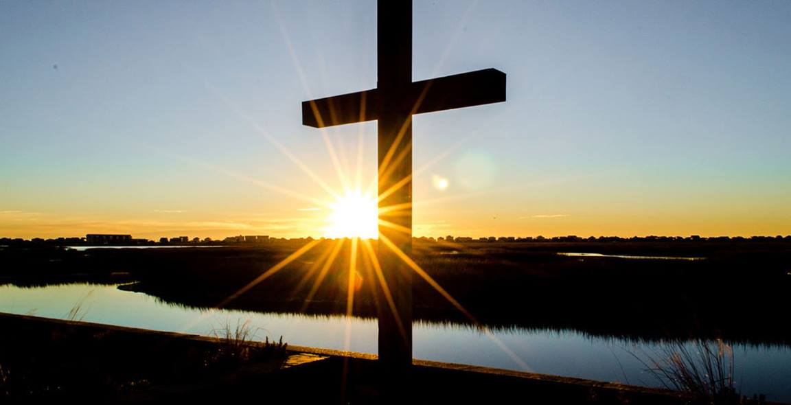 Sunrise behind the cross at Belin Memorial United Methodist Church in Murrells Inlet, South Carolina by Austin Bond Photography.
