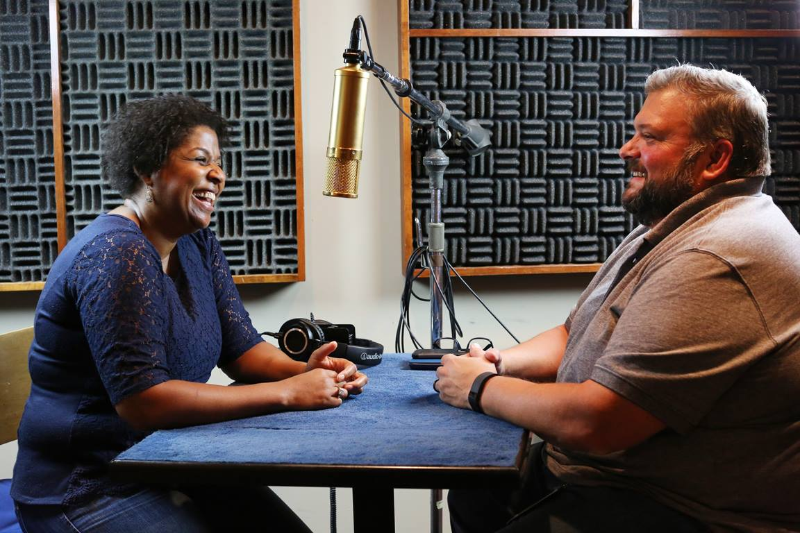 Podcast host Joe Iovino talks with the Rev. Sheila Bates, who shares ideas to help students find places to grow in their faith while they are away at college. Photo by Kathleen Barry, UNM News.