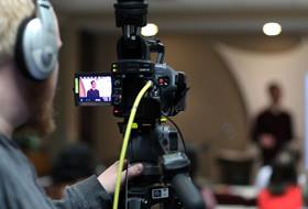 """Andrew Jensen video records David Kinnaman, president of the Barna Group, as he leads a presentation called """"The Seeker Context"""" at United Methodist Communications. Photo by Kathleen Barry, UM News."""