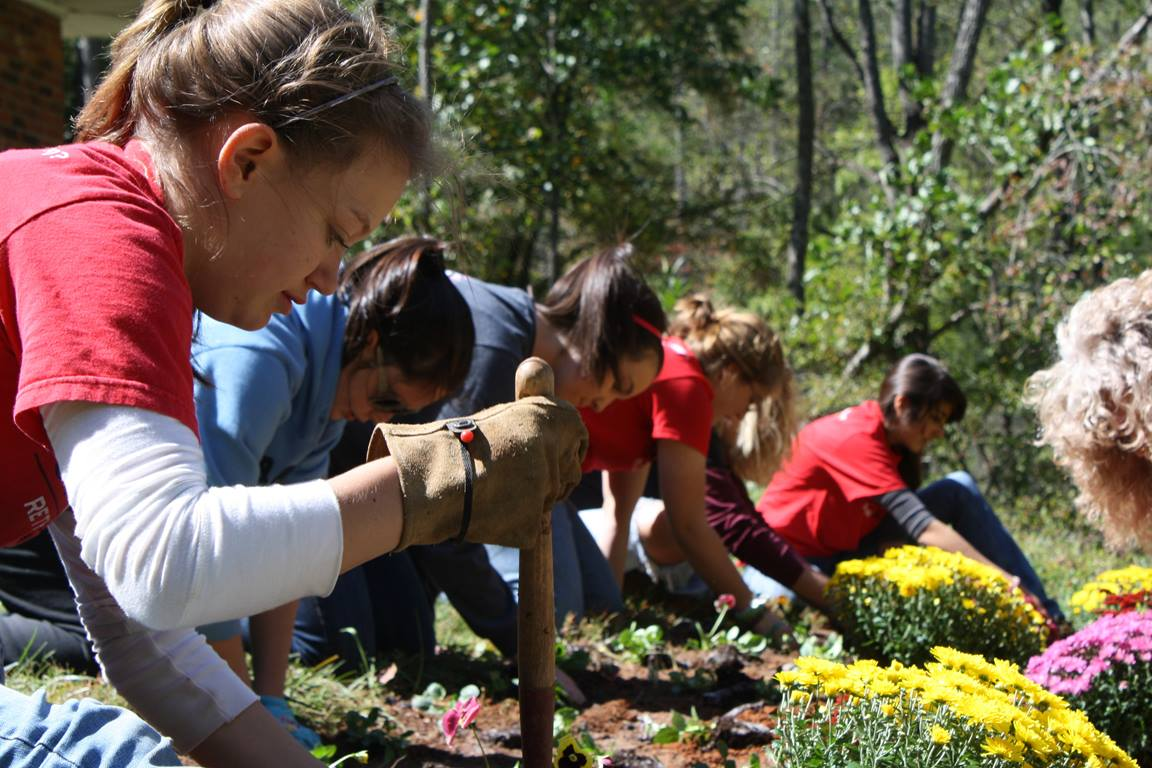 Young people volunteer at a community garden in Western North Carolina. Image courtesy of RETHINK Church.