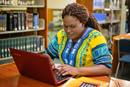A student works on a computer in the library on the campus of Africa University in Mutare, Zimbabwe. Photo courtesy of Africa University.