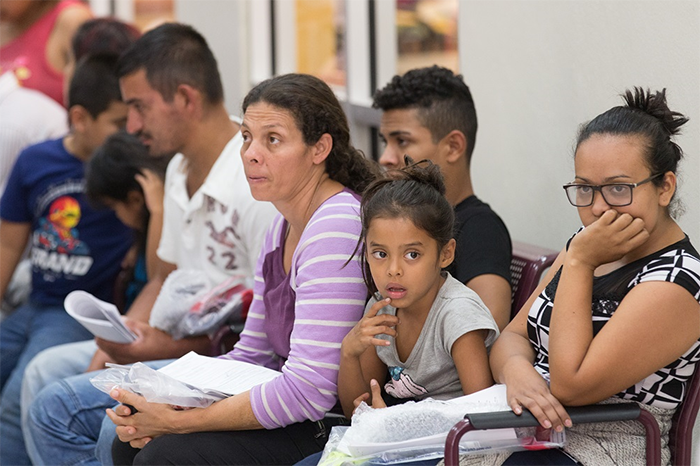 Immigrants who have just been released from a U.S. Border Patrol detention facility wait at the bus station in McAllen, Texas, in this photo from Aug. 1.