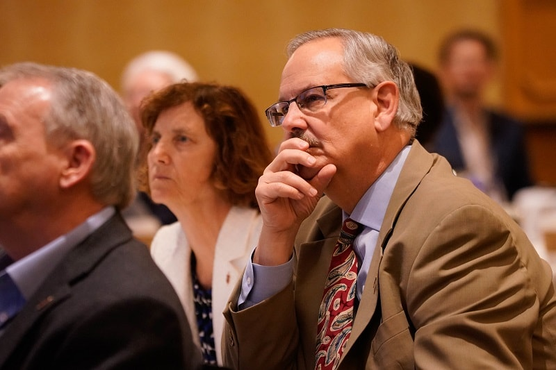 Bishop Laurie Haller (left), Bishop Bruce Ough (right) and other bishops listen to an legal presentation during their May 2019 meeting outside Chicago. Photo courtesy of Council of Bishops.