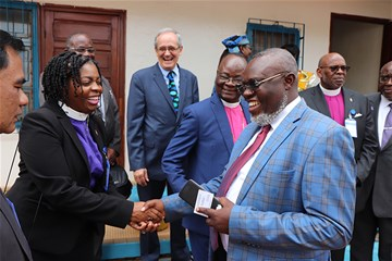 Western Pennsylvania Bishop Cynthia Moore-Koikoi shakes hands with Gangano Mangokube, ambassador from the Democratic Republic of Congo, during a November mission trip to the Central Africa Republic.