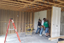 A work team from White's Chapel United Methodist Church in Southlake installs sheet rock and walls in the Chihowa Okla United Methodist Church multi-use building.