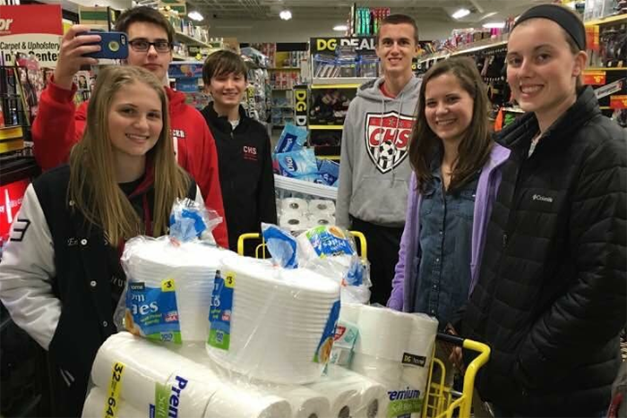 Kirstin King poses with other volunteers while shopping.