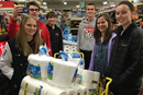 2017 picture of Kirstin King (far right) and her youth group who went shopping for items to put in a laundry basket for each Giving Tree family that they have at their congregation.