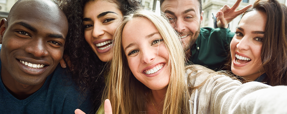 Stock photo of young people taking a selfie from freepik.com
