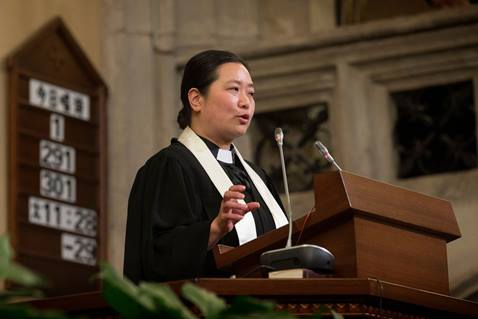 The Rev. Qianli Jiang delivers the sermon during worship at Mu'en Church in Shanghai, China. Photo by Mike DuBose, United Methodist Communications.