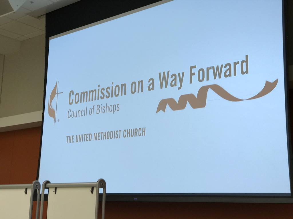 Photo of the group's logo shown on a screen during an earlier meeting. Photo by Diane Degnan, United Methodist Communications.