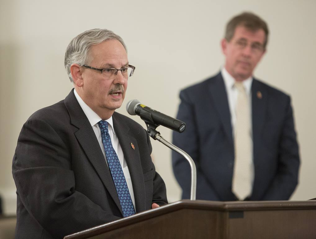 Bishop Bruce Ough (left) speaks during the oral hearing of the Judicial Council meeting on May 22, 2018. Also pictured (right), Bishop Scott J. Jones of the Texas Conference. Photo by Kathleen Barry, UMNS.