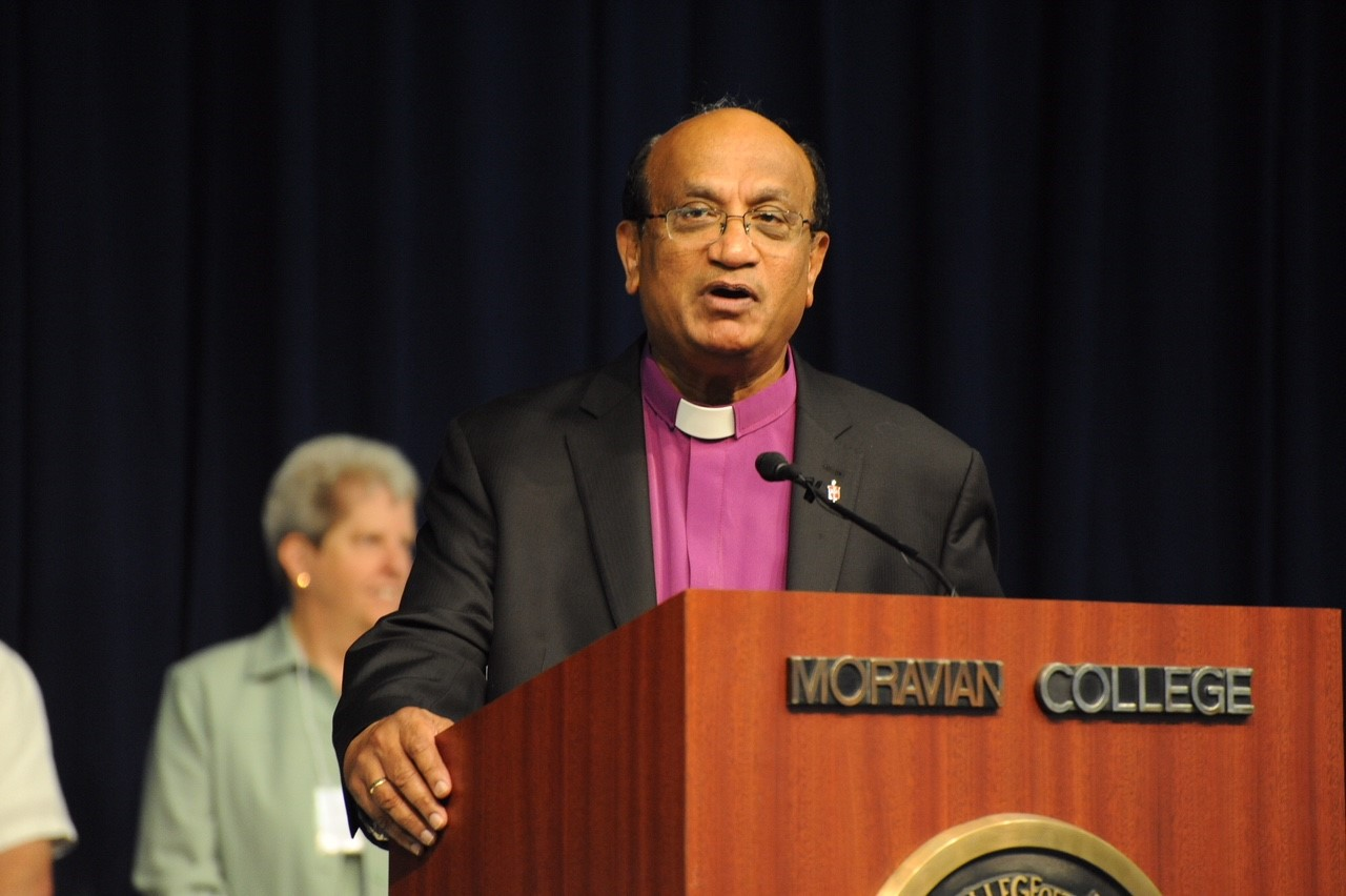 Bishop Sudarshana Devadhar of the New England Conference speaks following the passage of the resolution. Photo credit: Mike Reiss, The Moravian Church