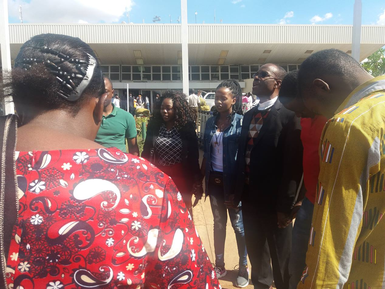 Malawian Miracle Osman and her supporters take time to pray to thank God for her safe return.