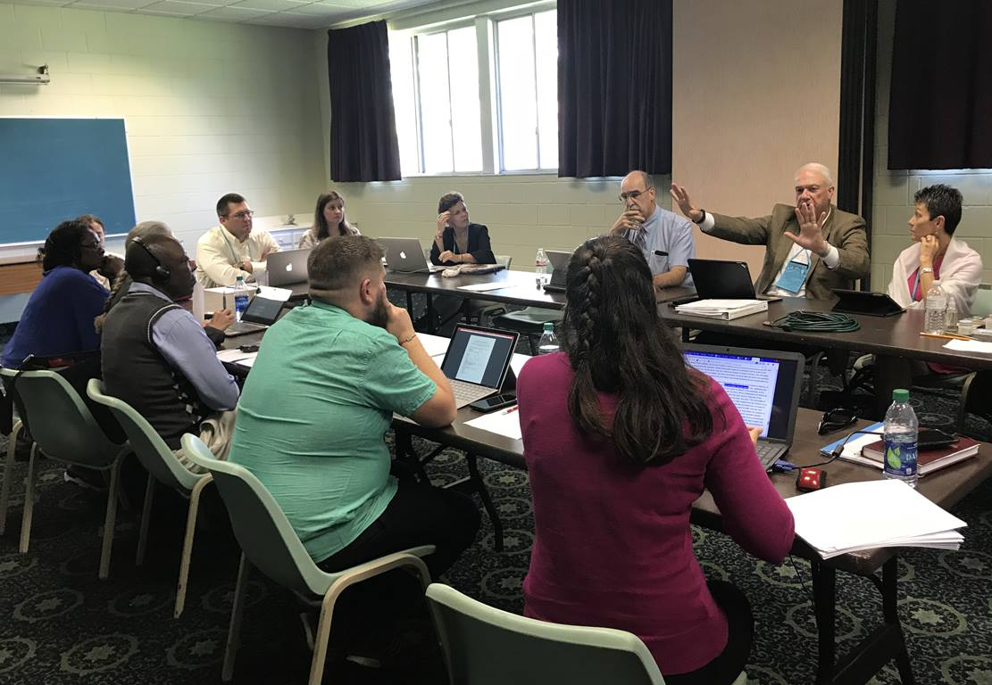 Members of the Rules Committee and Commission staff discuss a legislative structure for the 2019 Special Session of the General Conference. Photo by Diane Degnan, United Methodist Communications.