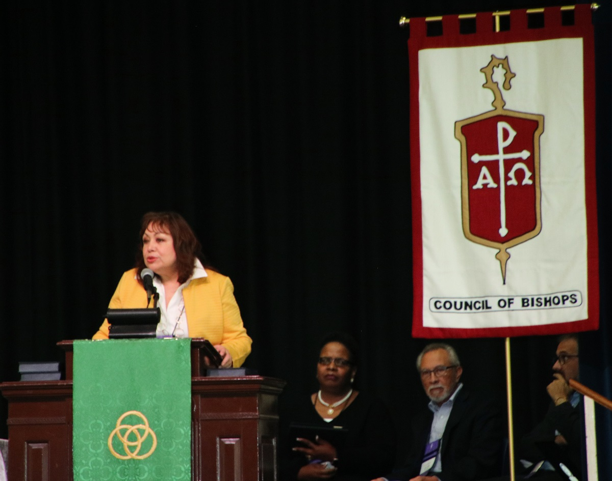 Bishop Minerva Carcaño, chair of the COB Immigration Task Force, presents the report and statement about immigration caravans during the plenary session at Epworth By the Sea on St. Simon's Island in Georgia. Photo by Maidstone Mulenga.
