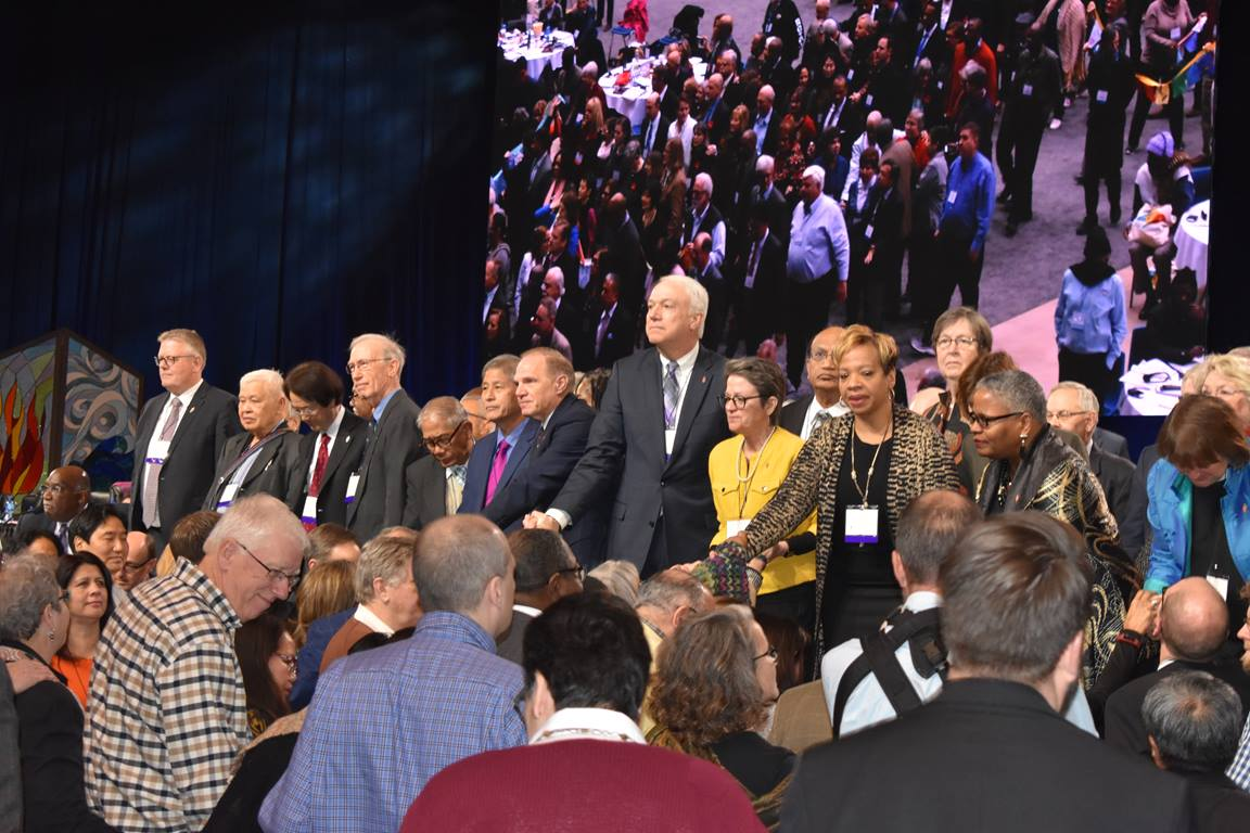 Bishops pray with delegates during the last day of the Special Session of the General Conference Tuesday in St. Louis.