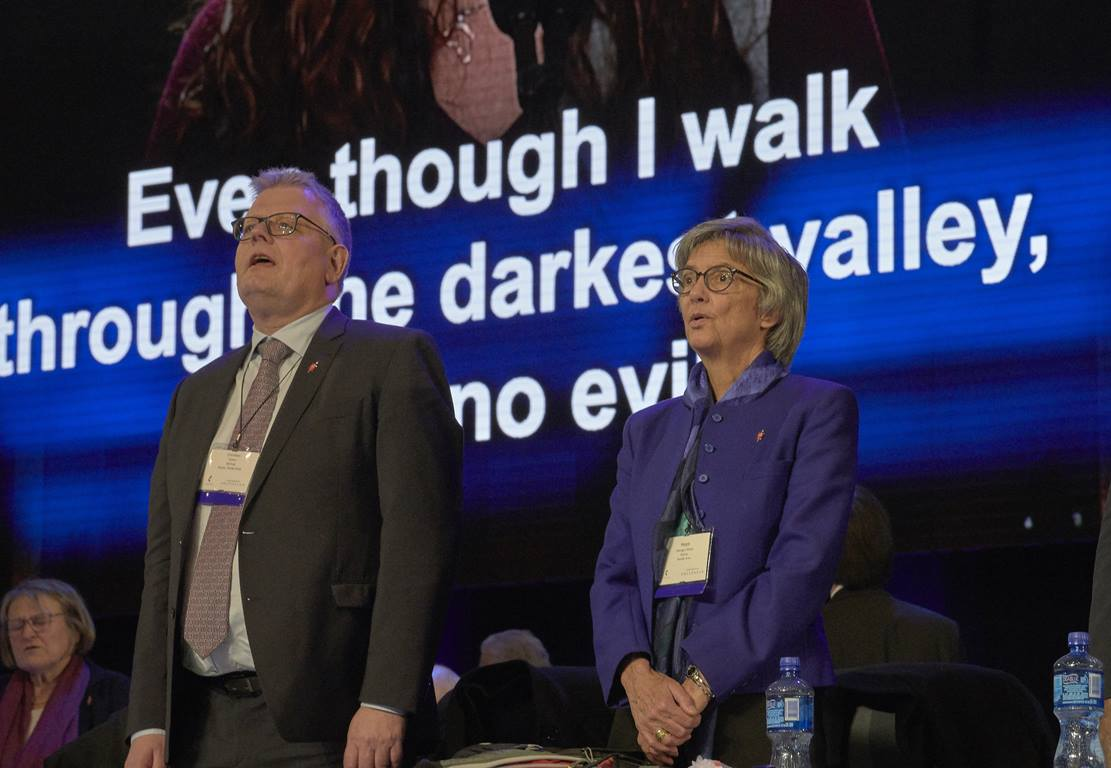 Bishop Christian Alsted and Bishop Hope Morgan Ward join in singing a hymn during closing worship of the Feb. 24, 2019, plenary session of the Special Session of the General Conference of The United Methodist Church, held in St. Louis.