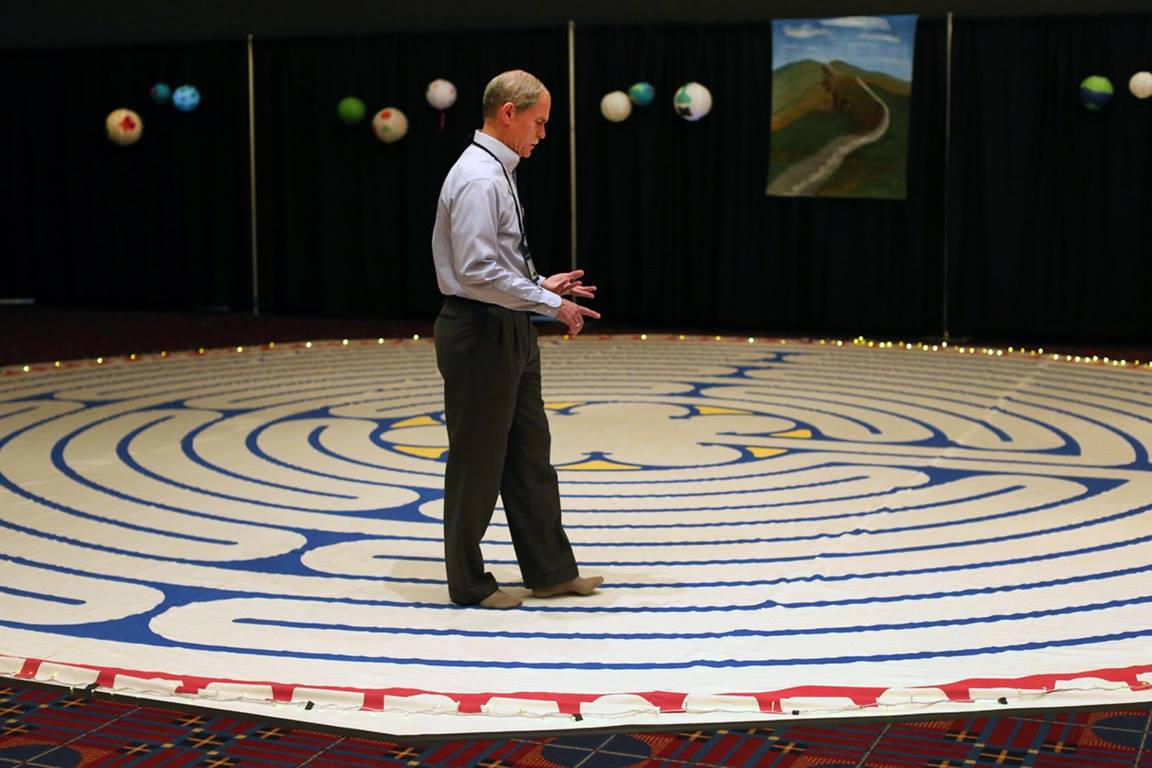 A man walks on a prayer labyrinth during General Conference 2016 in Portland, Oregon.  Photo by Kathleen Barry, United Methodist Communications.
