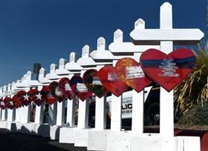 Crosses for each of the victims of a mass shooting in El Paso, Texas, being assembled before being taken to a memorial site. Photo courtesy of Reuters as provided by the Council of Bishops.