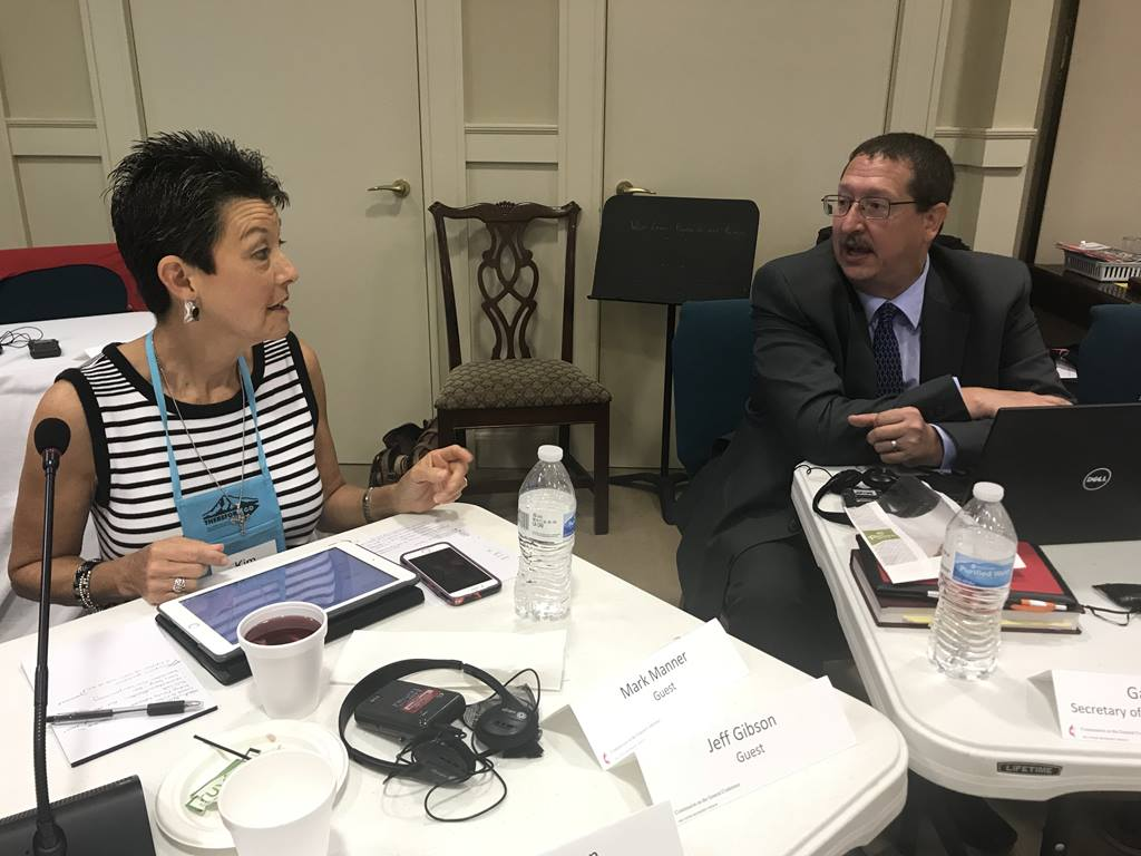Commission chair Kim Simpson confers with the Rev. Gary Graves, secretary of the General Conference, at a Commission meeting in Lexington, Ky.