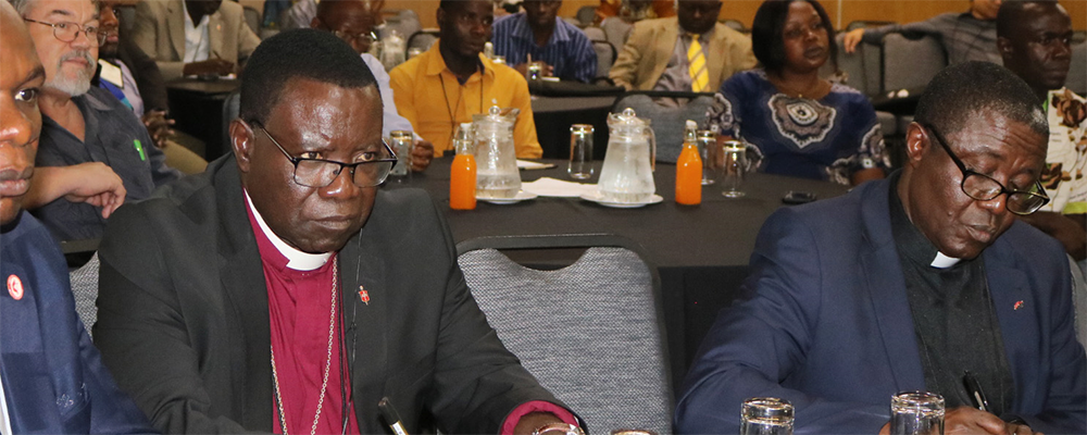 Bishop Kasap Owan from the South Congo Episcopal area (center) and delegates listen during the United Methodist Board of Global Ministries/United Methodist Committee on Relief agricultural summit in Johannesburg.